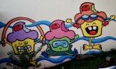 Os bolinhos da Maria Raquel Bolinho, pintados na parede de uma escola de natação na avenida Bandeirantes. Fotografado por Beto Trajano em 7.4.2014