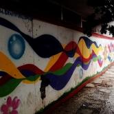 Grafite gigante na rua Sergipe, na Savassi, em um tapume de obra. Fotografado por CMC em 17.4.2014